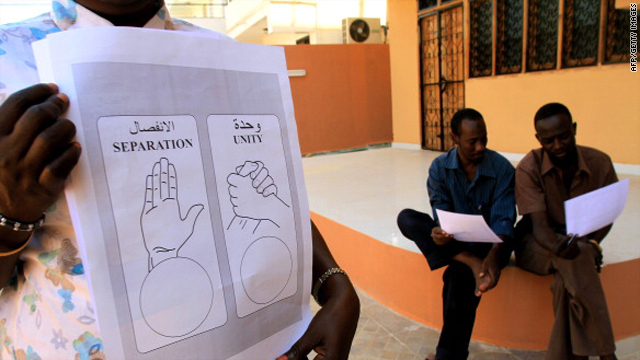 Sudanese look at an example of ballot slips at the Southern Sudan Referendum Commission offices in the Sudanese capital Khartoum on November 14, 2010.
