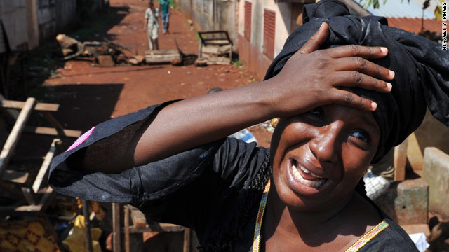 A woman cries on Thursday at the death of a relative killed in the wake of Guinean presidential elections.
