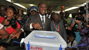 Ivory Coast's former PM and presidential candidate Alassane Ouattara casts his vote on Sunday in Abidjan.