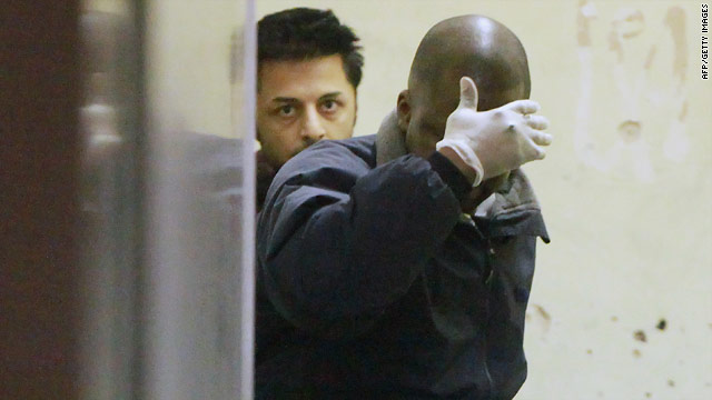 Shrien Dewani (seen at rear) leaves the City of Westminster Magistrates Court in London on December 8, 2010.
