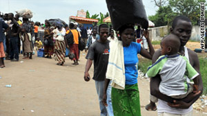 People wait in Abobo, a suburb of Abidjan, on Thursday for transport to visit their families during a general strike.