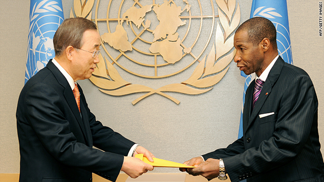 The new Ivory Coast Ambassador to the United Nations, Youssoufou Bamba, right, presents his credentials to U.N. chief Ban Ki-Moon on Wednesday.