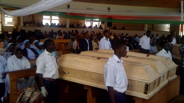 A mass burial service is held Friday for the victims of the bomb blast in Jos, Nigeria, on Christmas Eve.