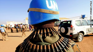 U.N. forces keep guard as the Qatari Minister of State for Foreign Affairs arrives in Darfur in November.