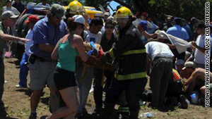 Emergency personnel help spectators who were hurt after a vehicle went off the course during the Dakar Rally.