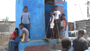 Members of Youth for the Development of Shada clean a toilet built in their community.