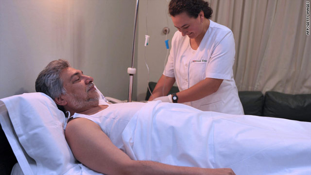 A nurse prepares Paraguayan President Fernando Lugo for surgery, January 8, 2010.