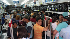 People crowd a store in Caracas, Venezuela, on Saturday, after the nation's currency was devalued.