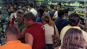 Venezuelans jam into an appliance store last weekend in anticipation of price hikes.