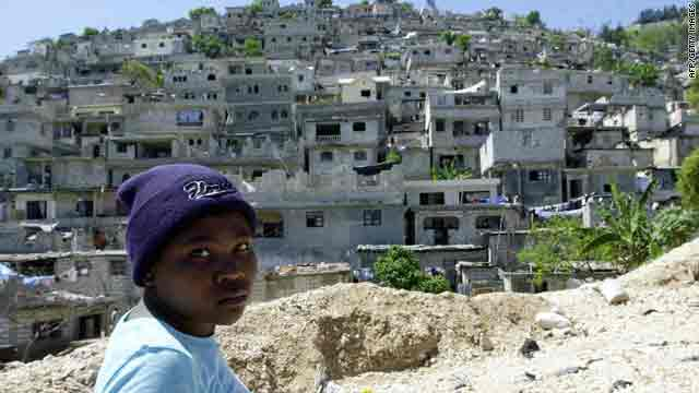 "Hills surround Haiti's capital, Port-au-Prince. Haiti's ambassador says ""little flimsy houses"" cling to the hillsides."