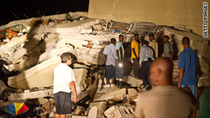 A devastating earthquake leaves much of Haiti's capital in ruins. People search for survivors at a supermarket Tuesday.