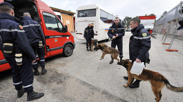 French search teams with sniffer dogs prepare to leave for Haiti, as nations rally to offer assistance.