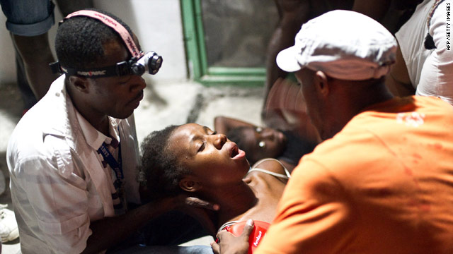 A woman faints in the arms of a medic at an emergency clinic in Port-au-Prince, Haiti.