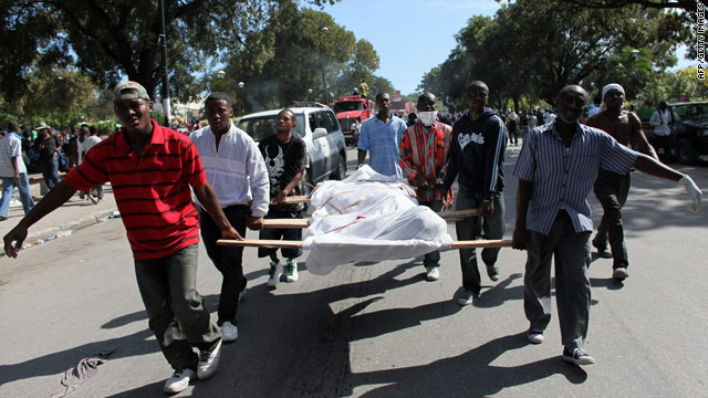 Men carry bodies for burial down a street in Port-au-Prince, Haiti, on Thursday. The earthquake's death toll is unknown.