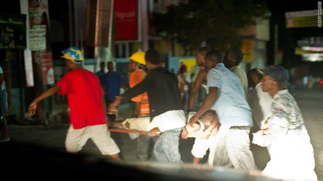 An injured Haitian is carried on a litter shortly after a magnitude 7.0 earthquake struck near Port-au-Prince.