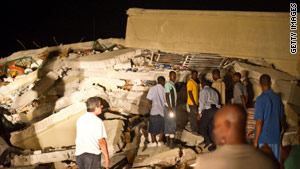 Regine Madhere reportedly has been texting from beneath a collapsed market in Port-au-Prince.