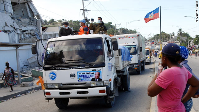 A convoy of trucks carrying relief supplies rolls through the Petionville suburb of Port-au-Prince.