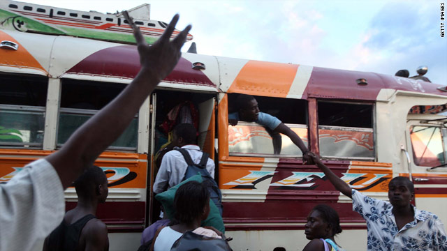 People prepare to leave Port-au-Prince, Haiti, on a bus Saturday.