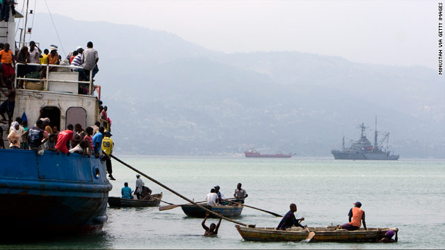 People try to leave Port-au-Prince, Haiti, by boat on Wednesday, destination unknown.