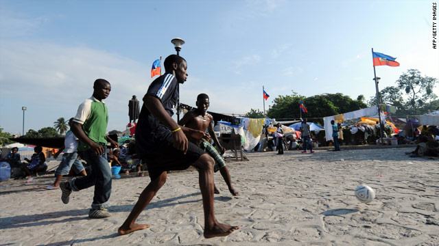 Haitian earthquake survivors take a break and play soccer at a park that is now a refugee camp in Haiti's capital.