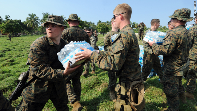 U.S. Marines load a U.N. truck with water to be distributed among Haitian earthquake survivors in Leogane on Wednesday.