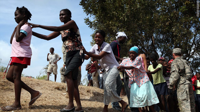 Haitians line up to receive food and water Wednesday at a U.S. Army distribution point in Port-au-Prince, Haiti.