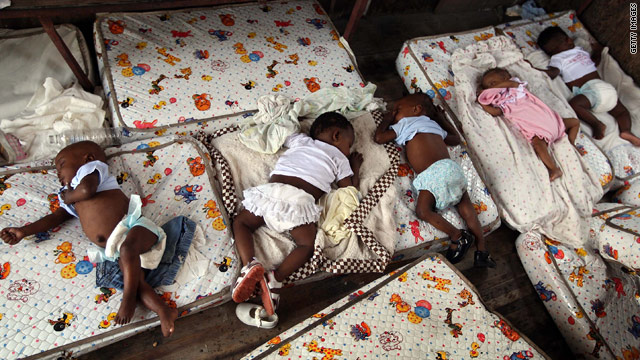 Haitian orphans rest on mattresses in a truck this week at the Maison des Enfants de Dieu orphanage in Port-au-Prince.