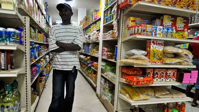 Some small grocery stores are starting to reopen in Port-au-Prince. This man looks for necessities Thursday.