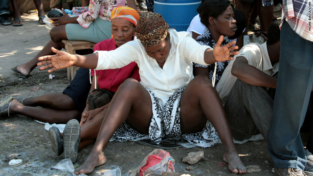 Earthquake victims offer up prayers in a Port-au-Prince tent city Saturday.