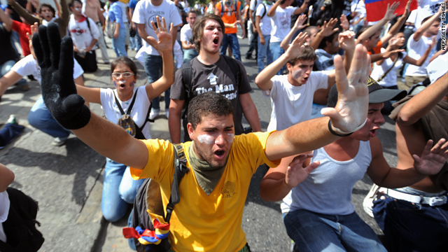 Students shout slogans at a protest against the suspension of the signal of private RCTV broadcaster in Caracas on Monday.