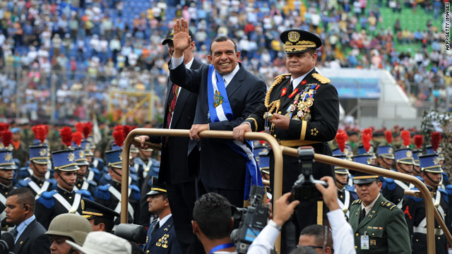 "Honduran President Porfirio ""Pepe"" Lobo Sosa, center, reviews a military guard during Wednesday's inauguration in Tegucigalpa."