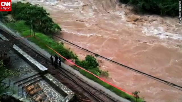 An image shot by iReporters stranded after floodwaters cut railway lines.