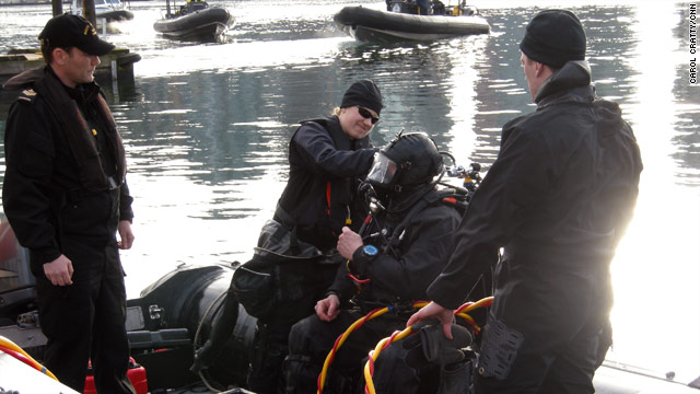 A diver from the Canadian Navy practices during a security drill in Vancouver, honing his bomb detection skills.