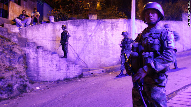 Colombian soldiers patrol a crime-ridden shantytown last month in Medellin. The city had more than 200 slayings in January.