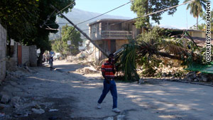 For Haiti to have electricity after last month's massive earthquake, thousands of power poles had to be righted.