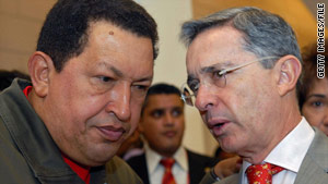 Hugo Chavez, left, gave his version of a verbal sparring match with Colombia's Alvaro Uribe.