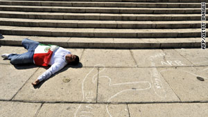 A protester against drug violence plays dead at a Mexico City monument earlier this month.
