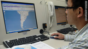 A meteorologist in Taiwan monitors the tsunami situation after Chile's earthquake Saturday.