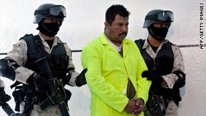A man local authorities identified as Aldo Favio Hernandez Lozana, center, is shown on Saturday in Juarez.