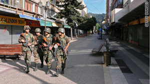 Soldiers patrol the streets during curfew hours in Concepcion, Chile.