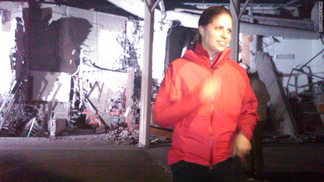Soledad O'Brien reports in front of a flattened building in Chile. She and her team have left Chile with mixed emotions.