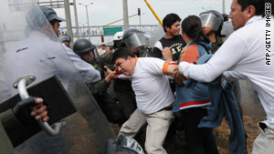 Demonstrations over plans to implement a new transport system in Bogota erupt into street clashes.