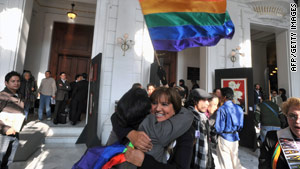 Couples celebrate the passage of Mexico City's same-sex marriage law in December.