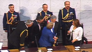 Television footage showed Sebastian Pinera's presidential inauguration proceeding without a hitch.