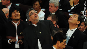 From left: The presidents of Bolivia, Paraguay and Ecuador react to a quake in Congress in Valparaiso, Chile.