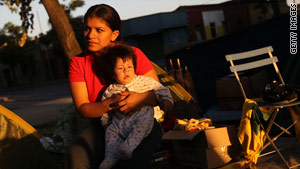 Many Santiago residents such as Victoria Paredes and her baby, Brack, are in makeshift homes after the quake.