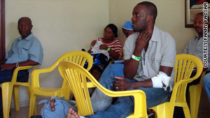 Haitian quake survivor Georges Exantus waits for a bus that will take him back to Port-au-Prince.