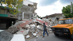 A man walks past the rubble of a health center in Port-au-Prince, Haiti, on Monday.
