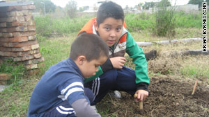 """It's like my happiest place to be,"" says 9-year-old Alexis Ocampo of the community garden."