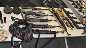 Pictures from the arrests showed an arsenal of weapons and ammunition seized during the captures.